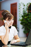 Woman laptop talking phone Stock Image