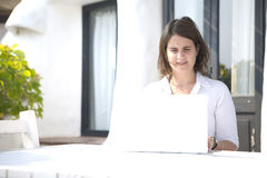 Woman with a laptop in a terrace Royalty Free Stock Photo