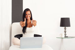 Woman with laptop and thumbs up Stock Photos