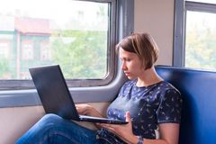 Woman with a laptop on the train stock image