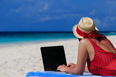 Woman with laptop on tropical vacation Stock Image