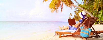 Woman with laptop on tropical vacation, panorama Royalty Free Stock Images