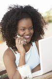 Woman With Laptop Using Cell Phone Stock Images