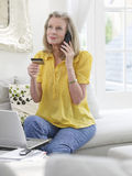 Woman With Laptop Using Credit Card And Phone Stock Photo