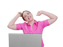 Woman at laptop very excited. Happy young lady working at her desktop on a notebook computer Stock Image