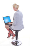 Woman with a laptop. View from back Stock Photos