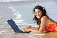 Woman with laptop in water Stock Photography