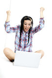 Woman with laptop on white sheet in her bed Stock Images