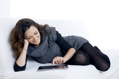 Woman with laptop on white sheet in her bed Stock Photo