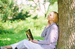 Woman with laptop work outdoors lean tree. Minute for relax. Education technology and internet concept. Girl work with stock images