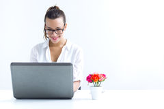 Woman with laptop working at home. Beautiful young woman with laptop working at home Stock Photography