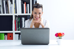 Woman with laptop working at home. Beautiful young woman with laptop working at home Royalty Free Stock Photography