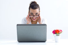 Woman with laptop working at home Stock Photos