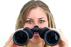 Woman with large binoculars Royalty Free Stock Photos