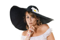 Woman in large black hat Stock Photo