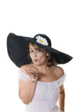 Woman in large black hat Stock Images