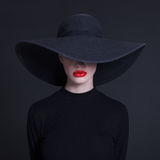 woman in a large black hat Stock Image