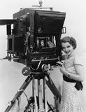 Woman with large camera Stock Photos