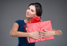 Woman with a large gift Stock Photos