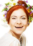 Woman with large hairstyle and flowers in her hair. Royalty Free Stock Images