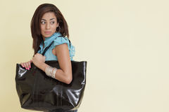 Woman with a large handbag Royalty Free Stock Photo