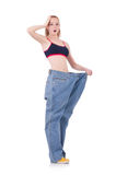 Woman with large jeans Royalty Free Stock Photo