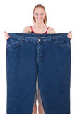 Woman with large jeans Royalty Free Stock Photos