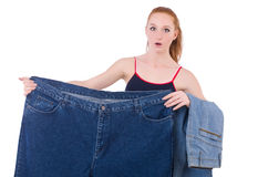Woman with large jeans Stock Image