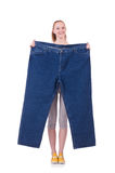 Woman with large jeans Royalty Free Stock Images