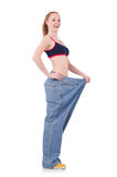 Woman with large jeans Royalty Free Stock Photography