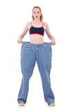Woman with large jeans Royalty Free Stock Image