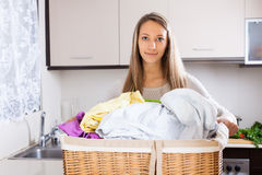Woman with large linen basket Stock Photography