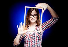Woman with nerd glasses and frame around her face Royalty Free Stock Images