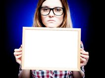Woman with nerd glasses holding empty frame, copyspace Royalty Free Stock Images