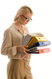 Woman with large pile of binders Stock Photos