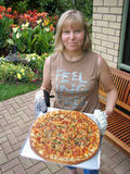 Woman with large pizza on tray Royalty Free Stock Photo