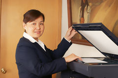 Woman and laser copier Stock Images