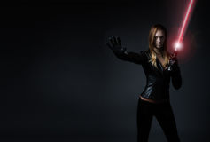 Woman with laser sword Royalty Free Stock Photos