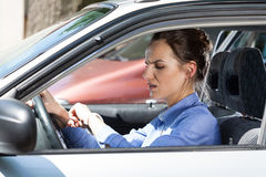 Woman late for work Stock Photo