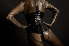 Woman in latex. Detail of woman wearing latex clothes Stock Images