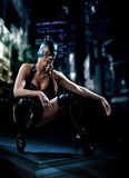 Woman in latex cat costume. Woman in leather black cat costume in the city at night royalty free stock photography