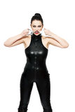 Woman in latex catsuit bite handcuffs Royalty Free Stock Photography