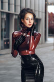 Woman in latex costume Stock Image