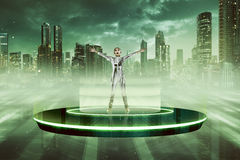 Woman in latex costume going to space with flying saucer. UFO concept Royalty Free Stock Images