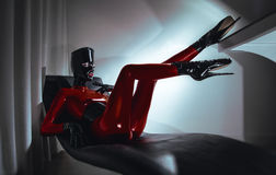 Woman in latex fetsih red costume. Woman in latex red costume stock photo