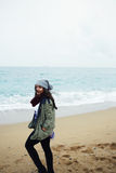 Woman with laugh standing near sea Stock Photo