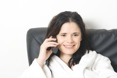Woman laughin on phone Stock Photo