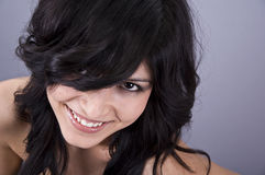 Woman laughing. Portrait of a beautiful young woman laughing, studio shot Royalty Free Stock Images