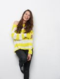 Woman laughing against white background Royalty Free Stock Images
