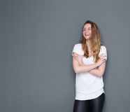 Woman laughing with arms crossed Royalty Free Stock Photography